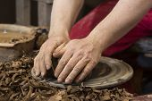 picture of loam  - hands of potter do a clay pot - JPG