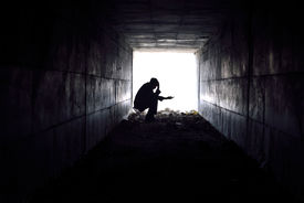 picture of underpass  - man waiting to help poor single - JPG