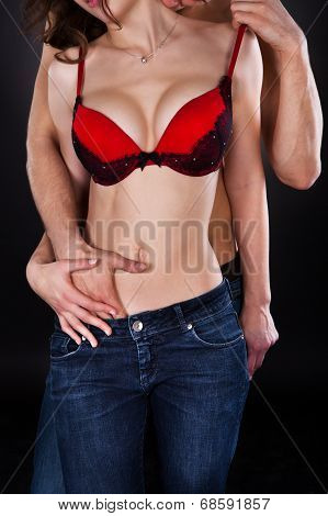Man Inserting Hand In Woman's Jeans While Kissing On Neck poster