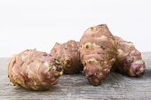 stock photo of jerusalem artichokes  - Topinambur root also known as Jerusalem artichoke  - JPG