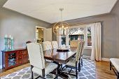 image of ivory  - Elegant dining room interior with wooden table and ivory suede chairs - JPG