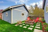 pic of grass area  - Small backyard with shed and patio area - JPG