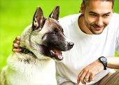 foto of dog park  - Man and Akita Inu dog walk in the park - JPG