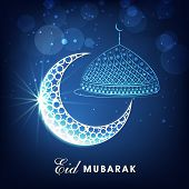 picture of eid festival celebration  - Muslim community festival Eid Mubarak celebrations concept with silver crescent moon and mosque on shiny blue background - JPG