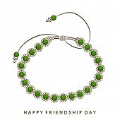 stock photo of friendship day  - Green pearl decorated friendship band on white background for Happy Friendship Day celebrations - JPG