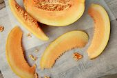 picture of cantaloupe  - Sliced cantaloupe on white  paper  - JPG