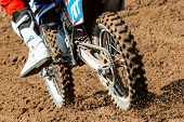 picture of motocross  - Detail view to the wheel of motocross bike - JPG