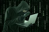 foto of cybercrime  - Portrait of hacker looking for user information by using magnifying glass - JPG