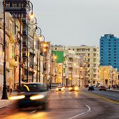 foto of malecon  - Sunset in Old Havana with  the street lights of El Malecon and light trails from the passing cars - JPG