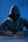 pic of hack  - Digital composite image of man wearing balaclava hacking laptop at desk - JPG