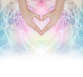 picture of wicca  - Hands forming a heart shape on a swirling pastel rainbow energy background fading into white at the base - JPG