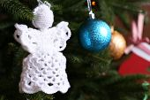 pic of christmas angel  - Knitted Christmas angels and other decorations on Christmas tree background - JPG