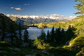 image of italian alps  - High altitude mountain lake at sunset in idyllic uncontaminated environment - JPG