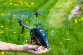 stock photo of helicopter  - Very dangerous moment to hold rc helicopter - JPG