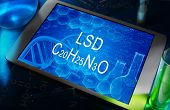 foto of lsd  - the chemical formula of LSD on a tablet with test tubes - JPG