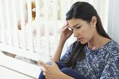 stock photo of natal  - Frustrated Mother Suffering From Post Natal Depression - JPG