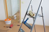 pic of roller door  - Ladder roller and paint buckets, home renovation ** Note: Shallow depth of field - JPG