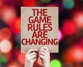 picture of change management  - The Game Rules Are Changing card with colorful background with defocused lights - JPG