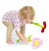 stock photo of unnatural  - Girl raises the floor flower - JPG