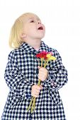 stock photo of unnatural  - The girl in an autumn coat with a bunch of flowers - JPG