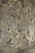 pic of dab  - the torn-off wall-paper on a wall with gray hard putty and with dabs of black paint ** Note: Visible grain at 100%, best at smaller sizes - JPG