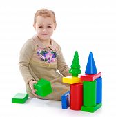 pic of montessori school  - Little girl playing with colored blocks sitting on the floor - JPG