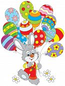 stock photo of cony  - Little rabbit walking with colorful balloons decorated like Easter eggs - JPG