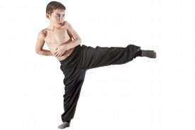 pic of karate-do  - karate boy doing kick in front of white background - JPG