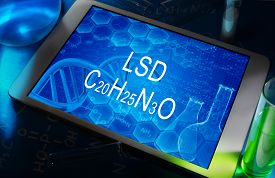 picture of lsd  - the chemical formula of LSD on a tablet with test tubes - JPG
