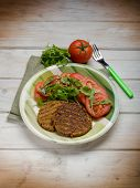 image of hamburger-steak  - soy steak with arugula and tomatoes salad - JPG