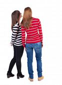 Постер, плакат: Back view of two young girl brunette and blonde  Rear view people collection backside view of