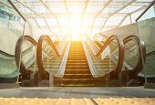 stock photo of escalator  - Blurry modern escalator at sunny day - JPG