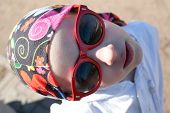 stock photo of cheater  - closeup portrait of cool young girl in bandana and big sunglasses - JPG