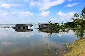 stock photo of flood  - home flood water refect sky help cloud - JPG