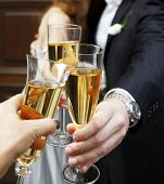 picture of champagne glass  - Glass of champagne in a hands of the groom and bride - JPG