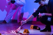 foto of murders  - Image of policewoman working on a murder scene - JPG