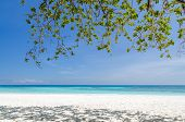 stock photo of crystal clear  - Crystal clear sea and white sand beach at Tachai island Andaman Thailand - JPG