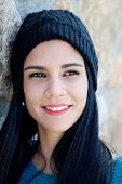 pic of piercings  - Pretty brunette girl with wool cap and piercing - JPG