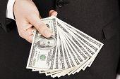 stock photo of one hundred dollar bill  - Businessman holding one hundred dollar bills on white background - JPG