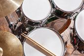 stock photo of drum-set  - Drumsticks are on the drum set top view - JPG