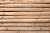 picture of log fence  - Natural background pattern of a log wall - JPG