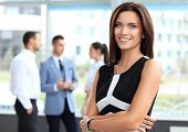 image of single woman  - Face of beautiful woman on the background of business people - JPG