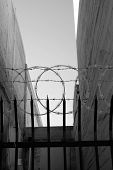 picture of barbed wire fence  - An inner city fence with sharpened vertical bars - JPG