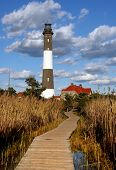 stock photo of lighthouse  - Fire Island Lighthouse with walkway leading to lighthouse - JPG