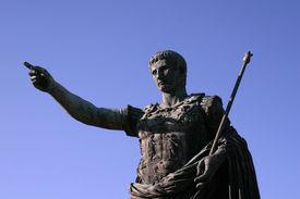 stock photo of spqr  - A statue of Caesar August points forward - JPG