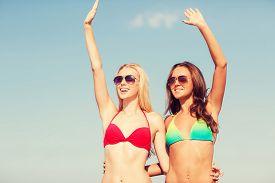 stock photo of waving hands  - summer vacation - JPG