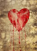 stock photo of broken-heart  - Broken and bleeding heart on the wall in grunge style - JPG