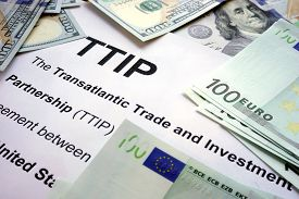 picture of lobbyist  - Word TTIP on a paper with dollars and euros - JPG