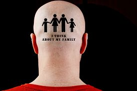 picture of male pattern baldness  - Text on the bald head I think about my family - JPG