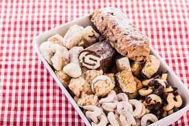 picture of crescent-shaped  - a heap of different homemade christmas pastry and cookies - JPG